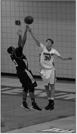 Jayden Gregory. Photo EditorLeft, junior center Ryan Mesh battles for the ball during the game against an ESU player. Top right, fans dressed up to look like Coach Mark Potter cheer for the Jets during the game. Bottom right, senior guard Darrell Traylor defends against Chris Sights of ESU.