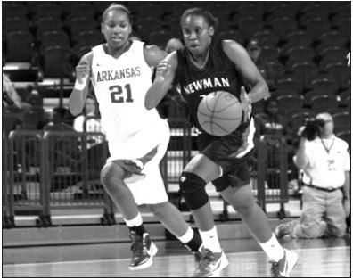 Photo courtesy of Newman UniversitySenior guard Kianna Flannagan dribbles against Arkansas last year.
