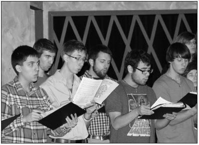 "Brandon Sweatman. PhotographerChorale members practice ""O Holy Night"" during class Wednesday."