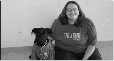 """Jayden Gregory, PhotographerJes and MickBie sport their """"I am a misfit"""" t-shirts with confidence."""