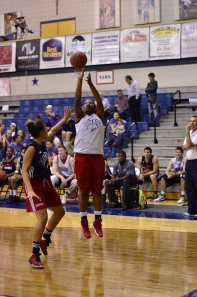 SENIOR SHEKEIRA COPELAND shoots a three-point shot at a scrimmage earlier in the season.  Max Pyle,  File Photo