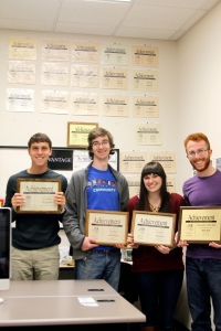 EDITORS MAX PYLE, JOHN DENNY, KATI BUSH AND MATT RIEDL with some of their awards won at the 2014 KCM conference. Riedl was awarded the Collegiate Journalist of the Year, snapping a two-year win streak by Wichita State University.